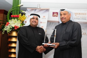 Ebrahim Al Rayes, Chief Executive Officer of Bahrain Kuwait Insurance Company B.S.C. receiving the award from Abdul Rahman Mohammed Al Baker, Executive Director - Financial Institutions Supervision, Central Bank of Bahrain.