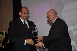 Ahmed Ismail Hassan, NBAD's Regional Manager in Egypt, (Left) receives the award on behalf of NBAD Asset Management Group.