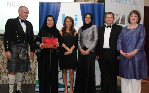 Dr. Lamees Abdul Majeed AlQaisi, the Group Head of Business Continuity Management at NBAD (second left), receives the BCM Team Award.