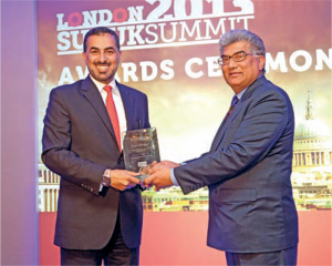 Cash&Trade contributor Mushtak Parker, the compere, presents an award to Emad Al Monayea of KFH Inv at the London Sukuk Summit