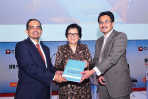 """Dr Nik Ramlah Mahmood, Deputy CEO of the Securities Commission Malaysia (middle) at the launch of the publication 'Islamic Capital Markets: Principles and Practices"""" with Prof Akram Laldin, CEO of The International Shari'ah Research Academy for Islamic Finance (ISRA) (left) and Mohd Izani Ghani, Chief Financial Officer, Khazanah Nasional Berhad (right)."""
